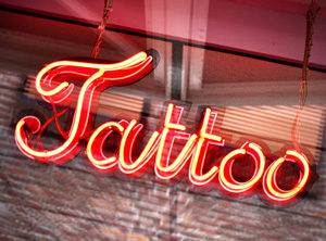 A neon tattoo sign to be displayed above a tattoo shop window