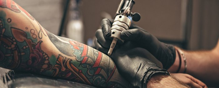 A traditional sleeve being tattooed